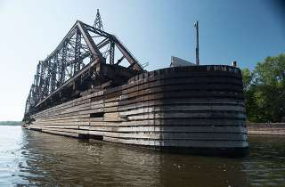 """La Crosse Swing Bridge. Built in 1876, updated in 1902, declared an """"unreasonable obstruction"""" in 1998 by the commandant of the U.S. Coast Guard. Plans were to replace the bridge, but never happened. There was a serious collision with the bridge in 2011"""