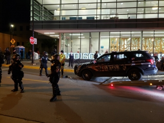 A tow truck is removing a police car that was vandalizedin downtown Madison Saturday night.