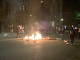 A trash fire in the middle of Johnson Street in downtown Madison on Saturday night.