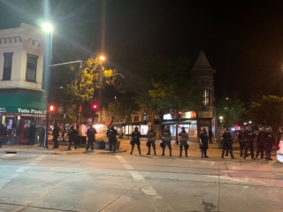 Police in riot gear block State Street in downtown Madison on Saturday night.