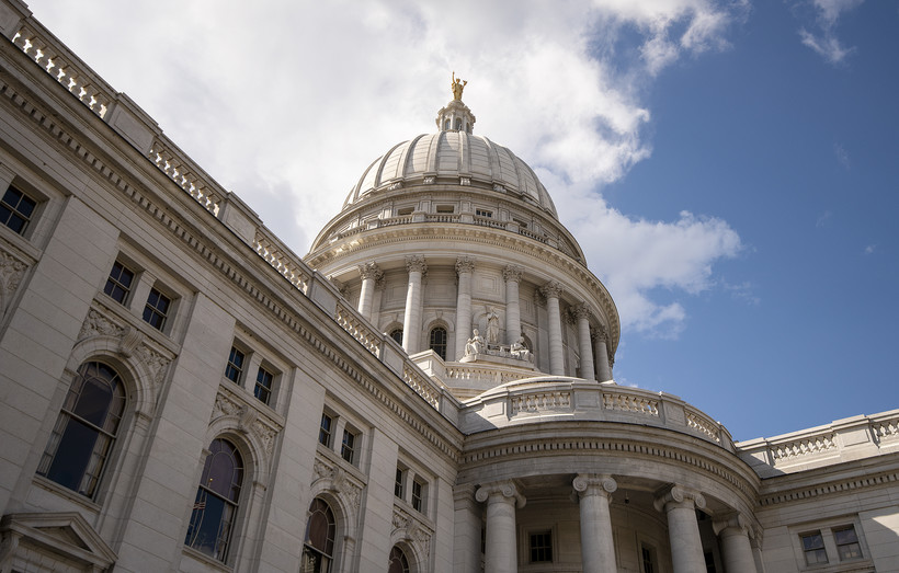 Clouds and a blue sky are seen behind the Wisconsin State Capitol