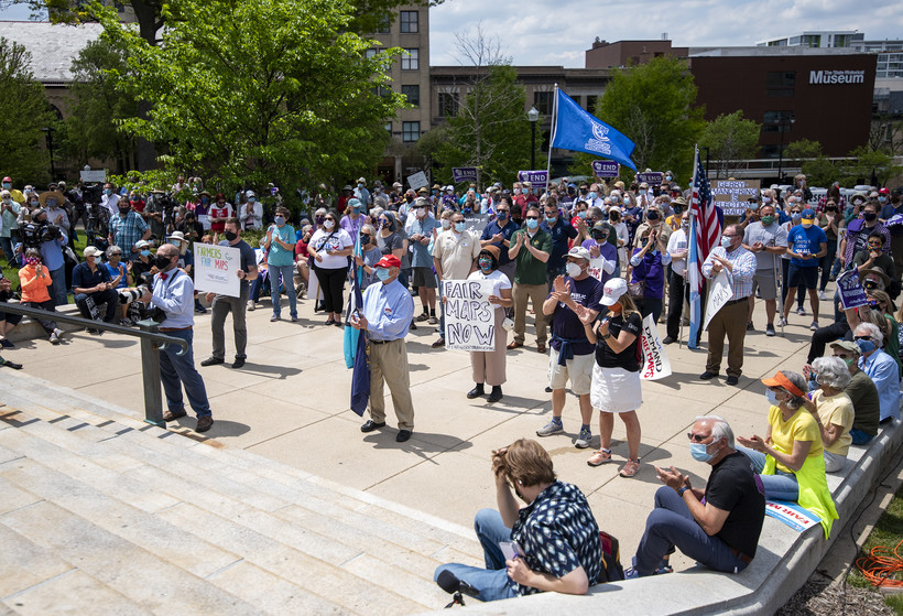 A crowd gathers on the steps of the Wisconsin State Capitol.