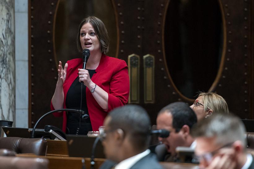 Rep. Katrina Shankland speaks into a microphone.