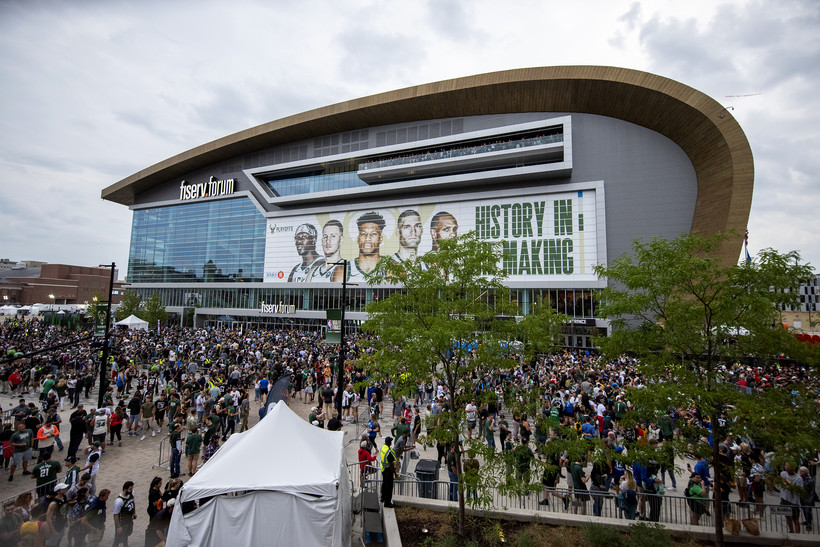 A sea of fans can be seen in front of the FIserv Forum.