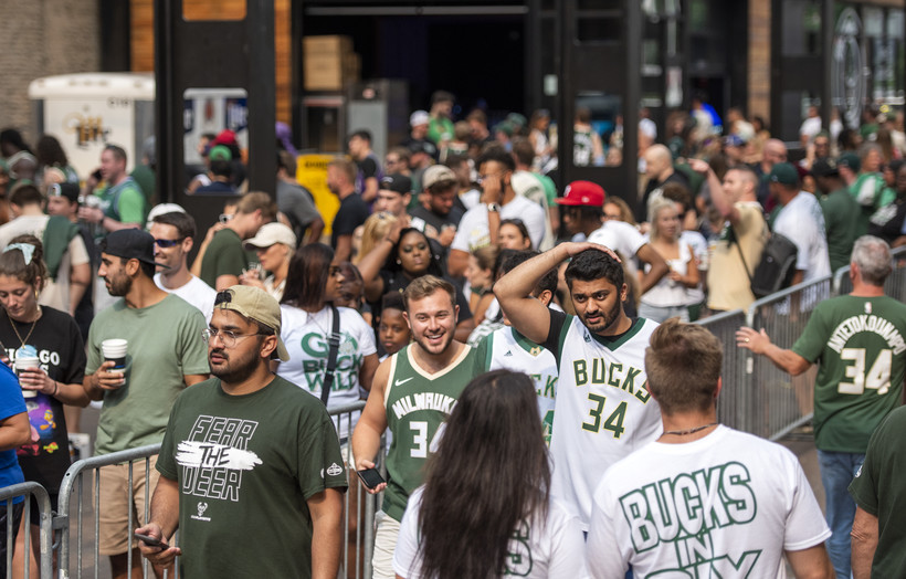 A crowd in Bucks t-shirts and jerseys gathers in the Deer District.