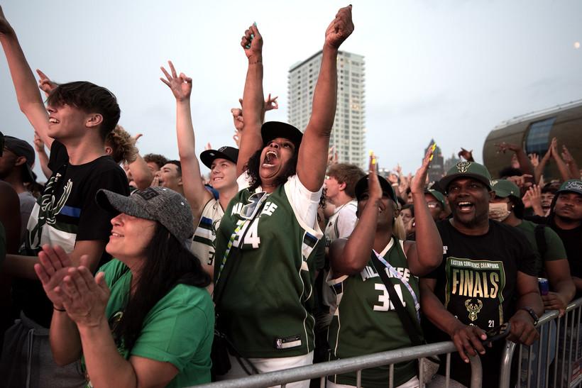 Bucks fans cheer in a crowd.