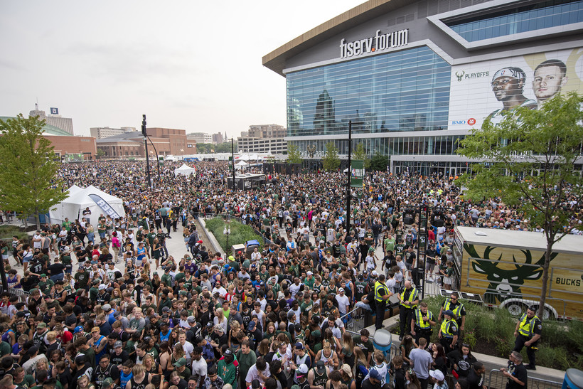 A sea of fans stands can be seen in front of the Fiserv Forum.