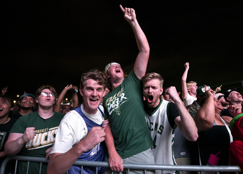 Fans cheer outside at the outdoor watch party.