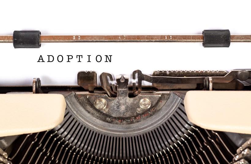 typewriter with type on paper spelling adoption