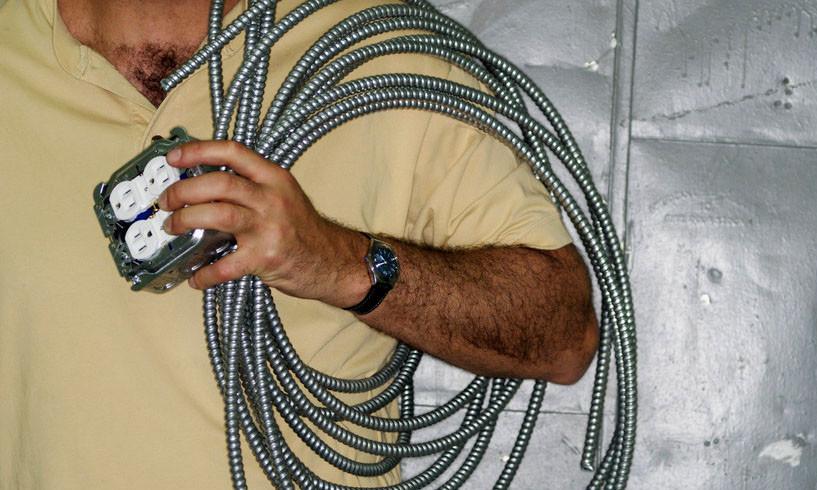 man carrying wiring
