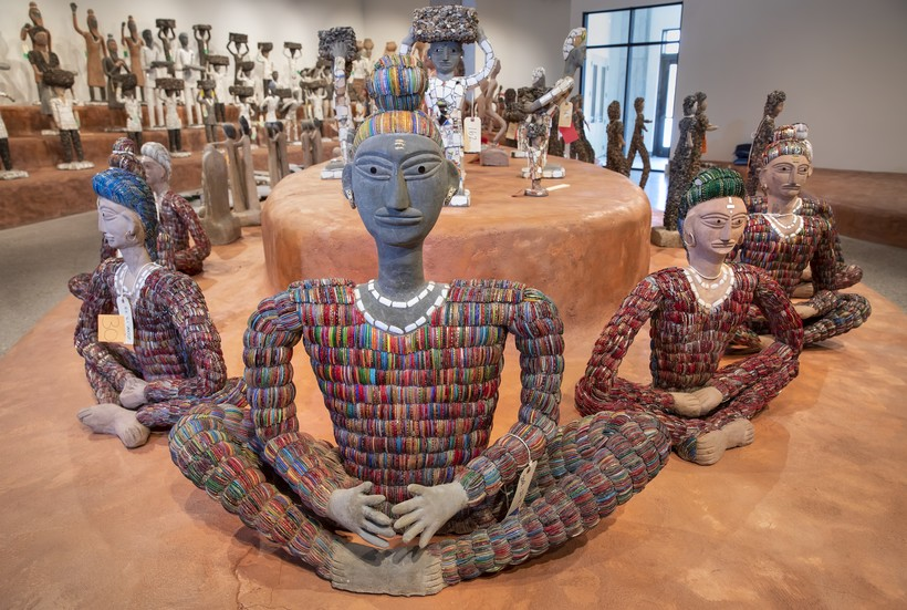 Works by Nek Chand, arranged on tiered platforms at the Art Preserve