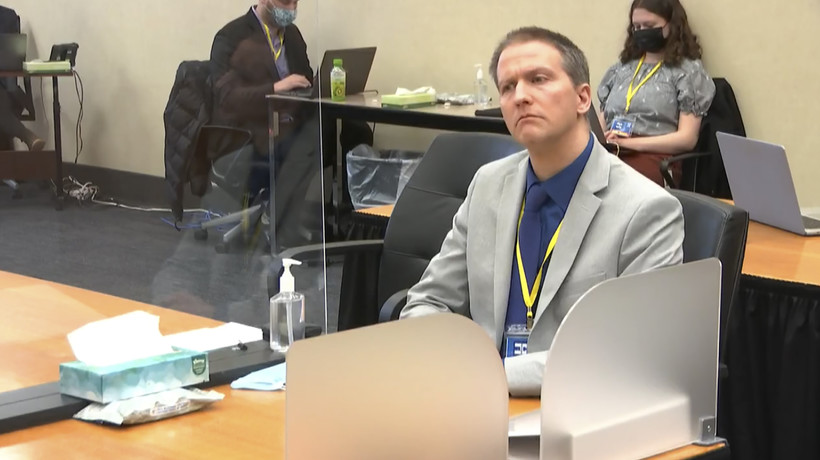 Derek Chauvin listens as attorney Eric Nelson gives closing arguments
