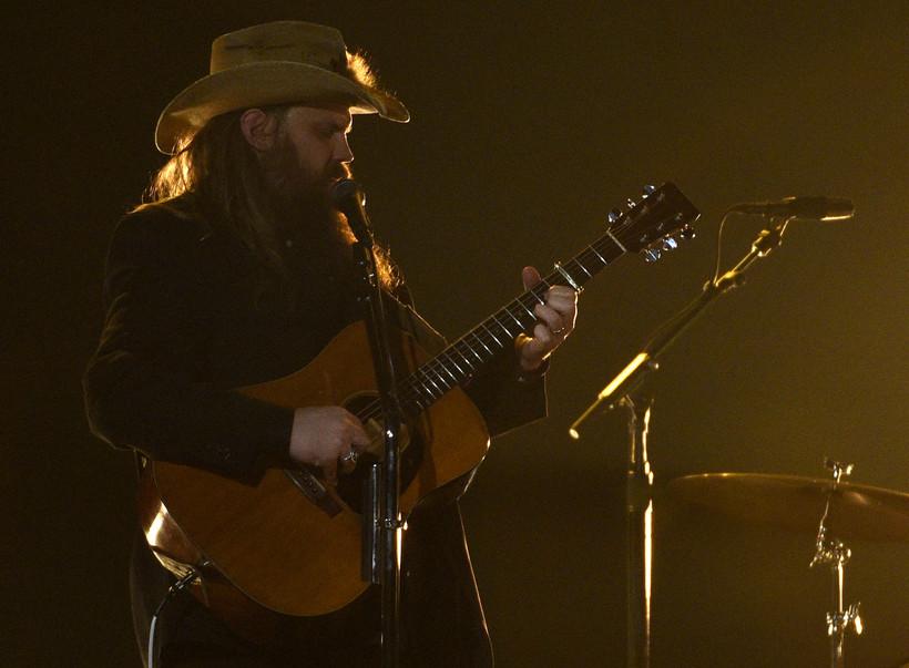 Chris Stapleton sings and plays guitar