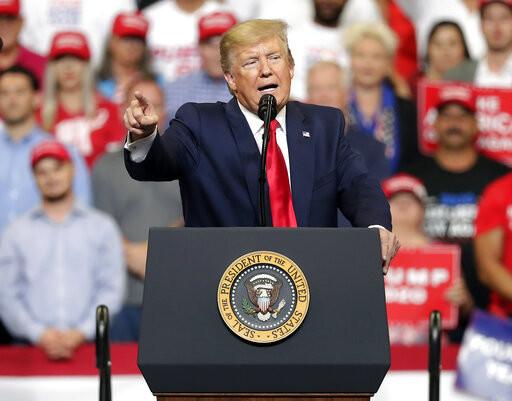 President Trump speaks at podium at rally