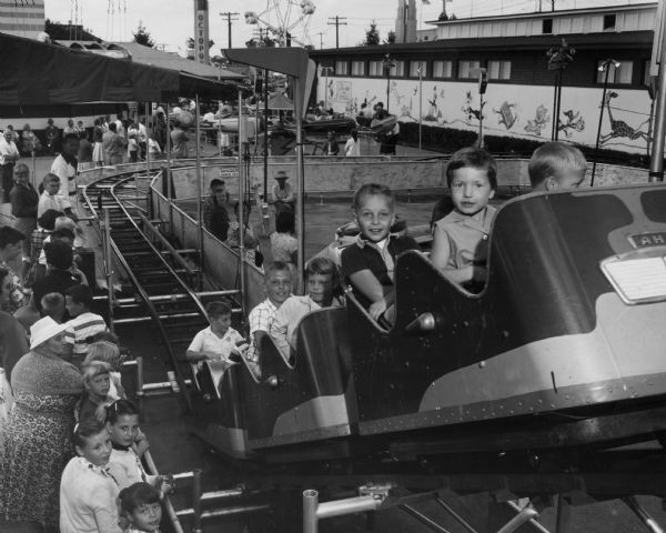 Childrenriding a roller coaster at the Wisconsin State Fair in West Allis