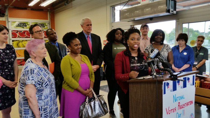 Shauntay Nelson of Wisconsin Voices speaks at a Tuesday news conference in Milwaukee