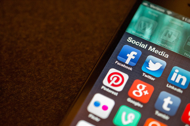 Photo of an iPhone with social media apps