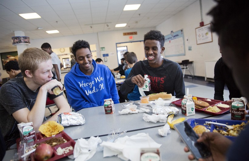 students eating in school cafeteria