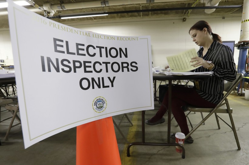 Woman looking over recount votes
