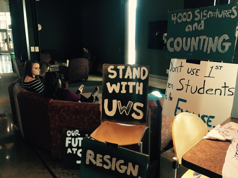 students protesting cuts