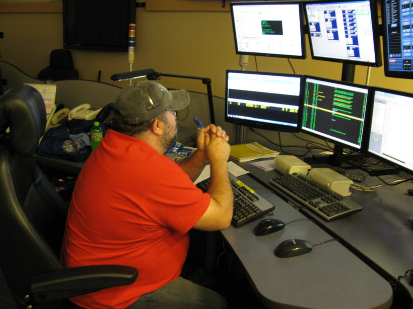 dispatcher works at 911 communications center