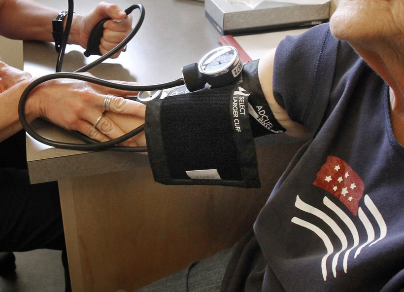 patient has her blood pressure checked