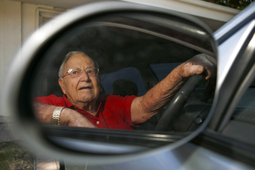 Jack Wyrad, 92, is seen reflected on his side mirrors