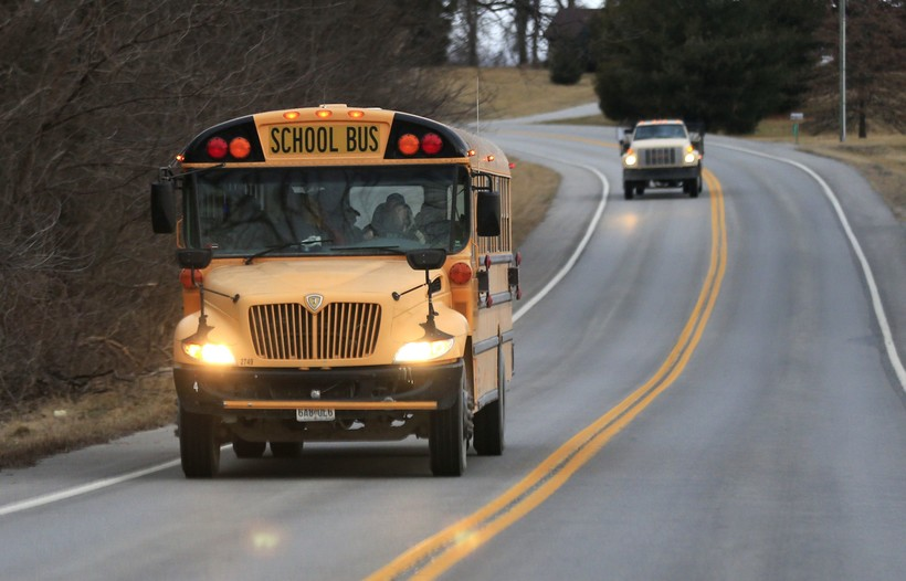 School bus driving down the road