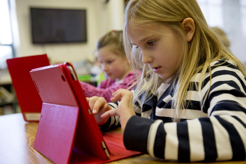 elementary student working on tablet