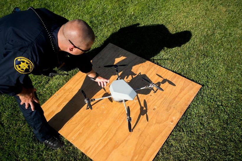 Sheriff's Deputy Dave Durbin prepares to fly a drone