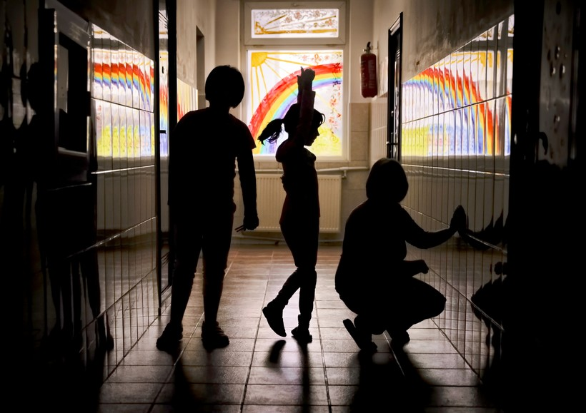 Child dances in hallway