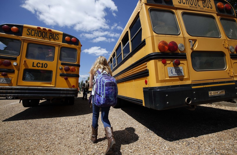 Students walking to school buses