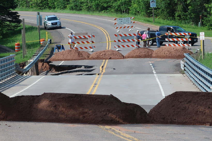 A bridge over the Black River in Douglas County was undermined due to flooding