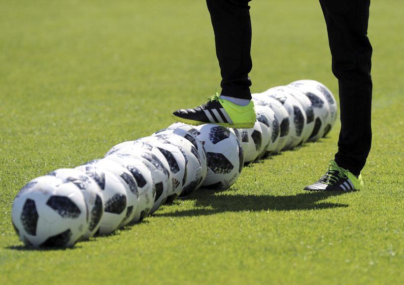 A coach prepares soccer balls at the 2018 soccer World Cup in Kazan, Russia