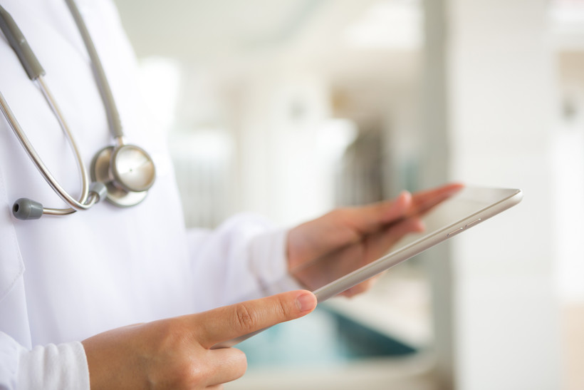 Doctor holding an iPad
