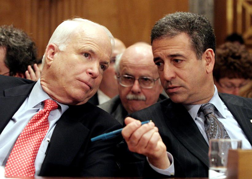Sen. John McCain chats with Sen. Russ Feingold on Capitol Hill