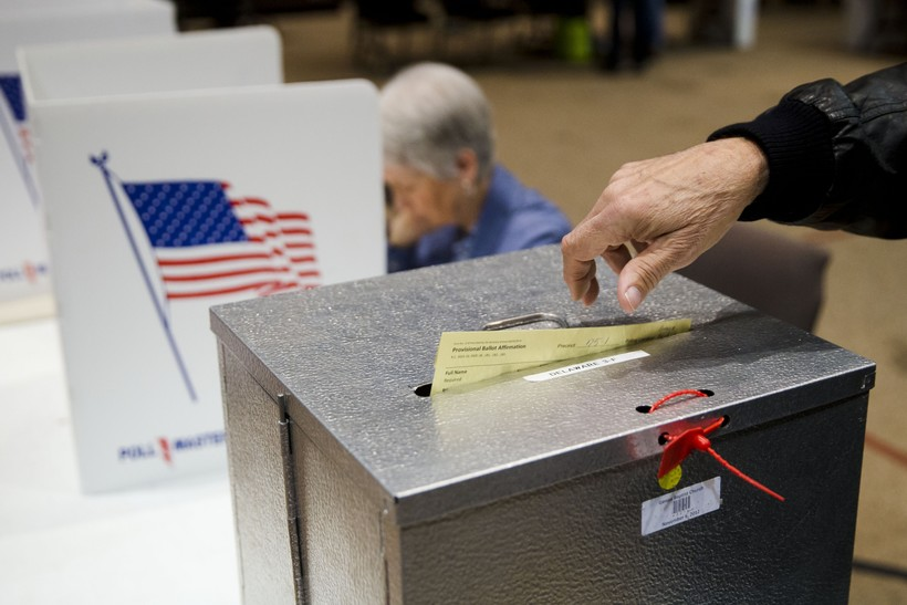 a primary election voter casts a provisional ballot