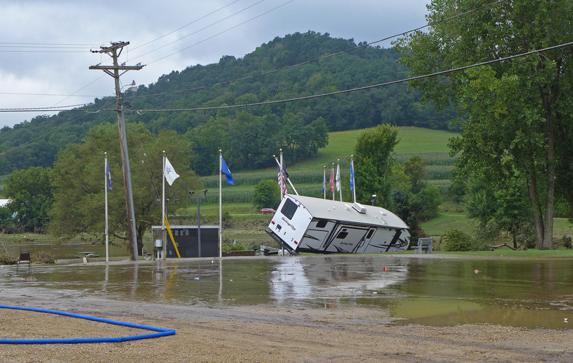An RV floated into the American Legion's flag poles