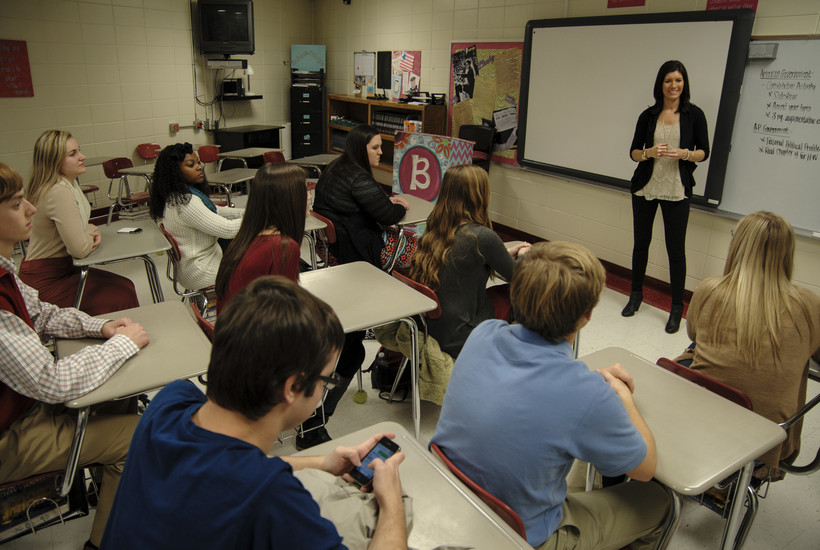 Students in a classroom with cellphones