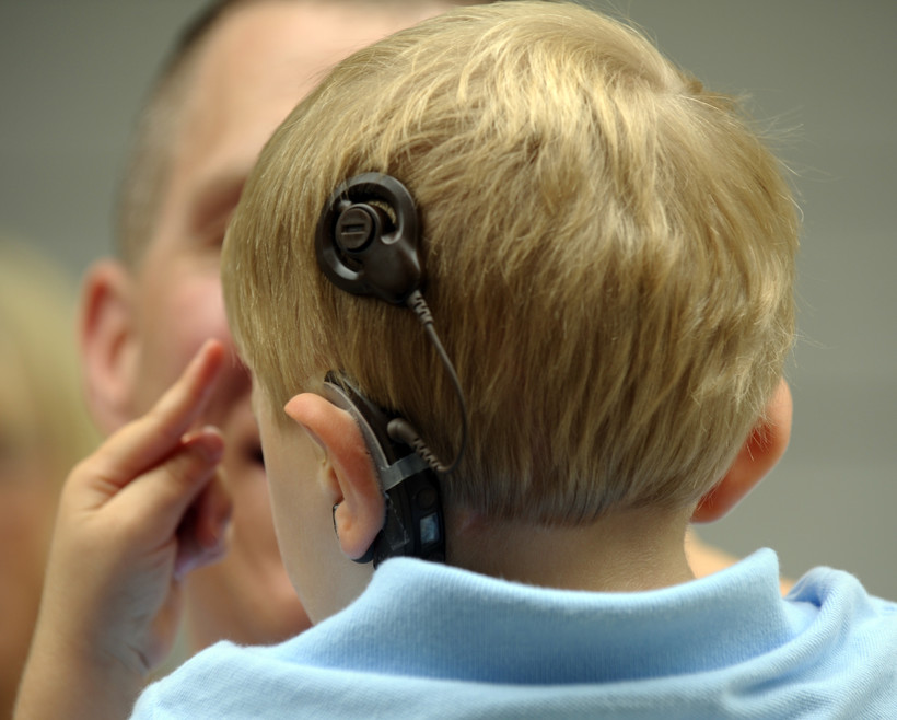 Boy with cochlear implant