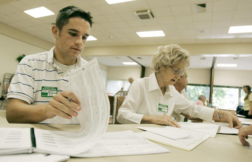 High School student Dan Garvey works at a polling station