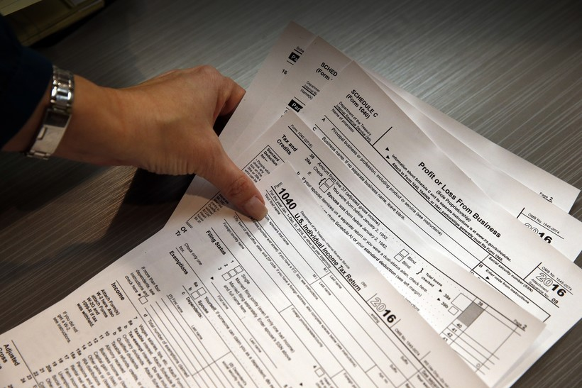 tax professional holds tax forms