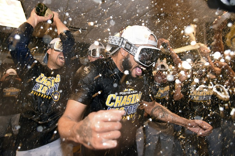 Milwaukee Brewers celebrate after sweeping the Colorado Rockies