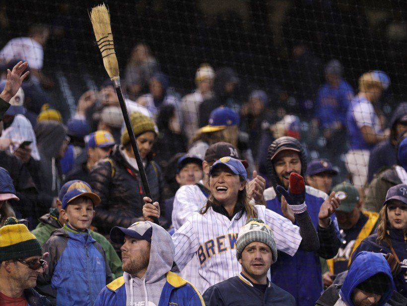 Brewers fan celebrates in the ninth inning of Game 3 of a baseball National League Division Series