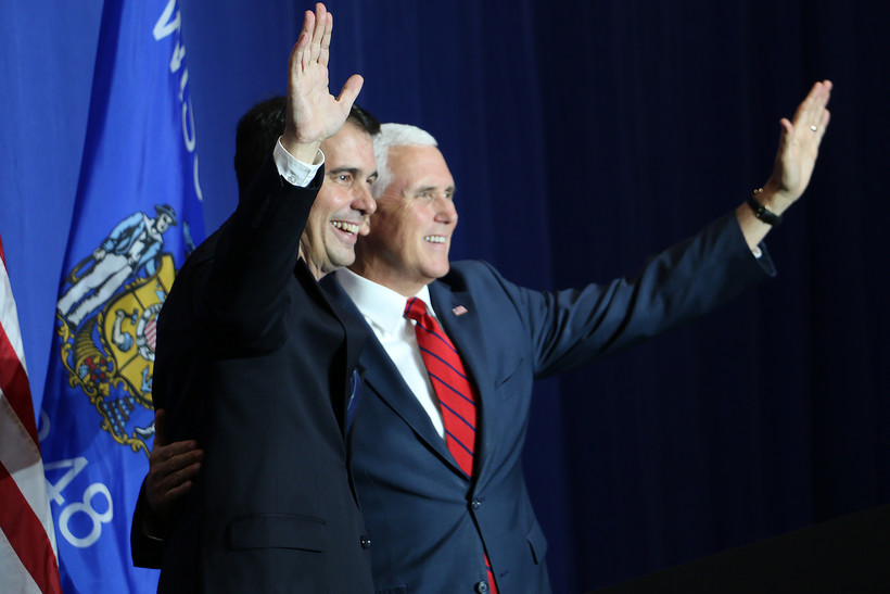 Vice President Mike Pence meets Gov. Scott Walker during a campaign fundraiser