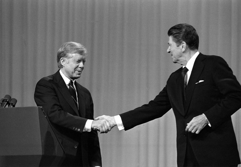 Jimmy Carter shakes hands with Ronald Reagan after debating in 1980