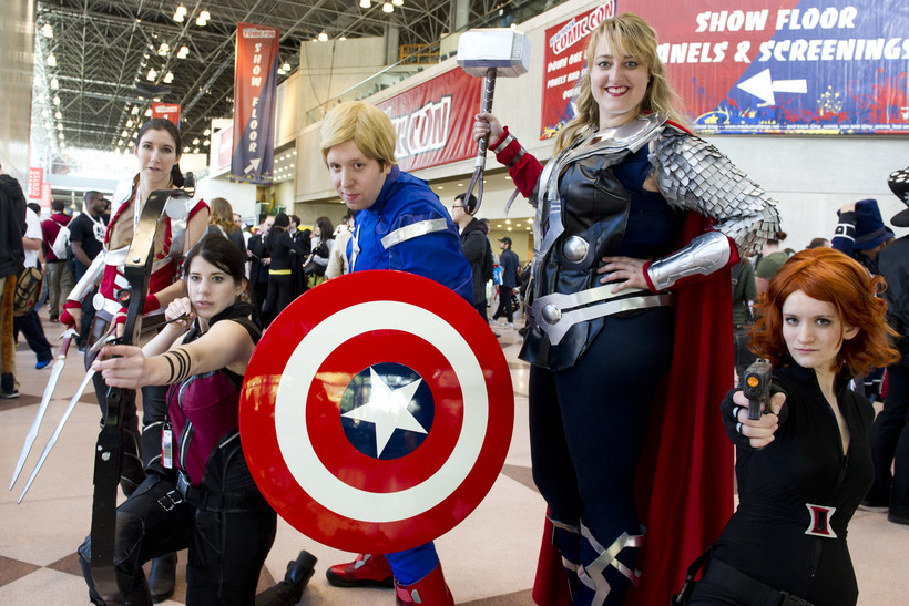 Male and female fans dressed as superheroes and comic book characters at Comic Con
