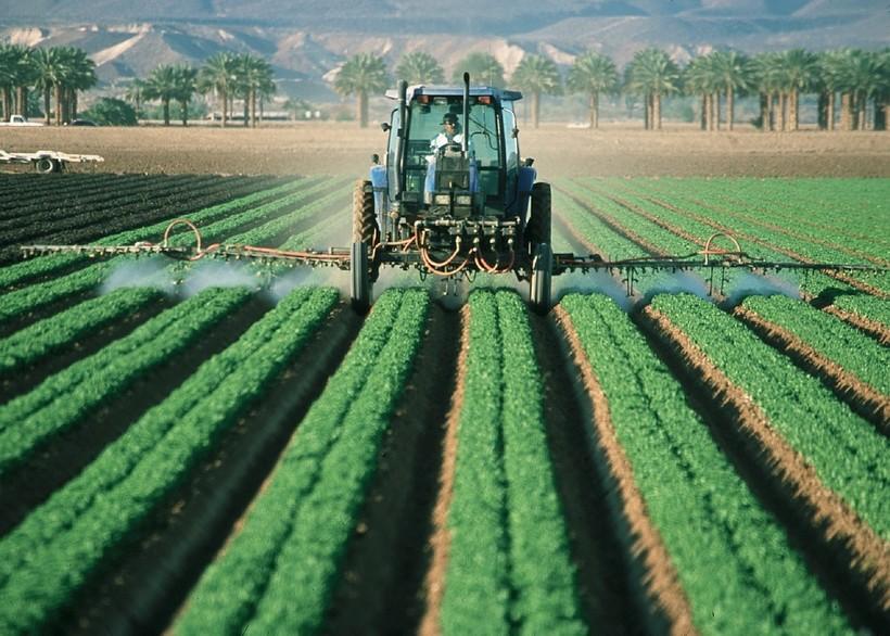 Tractor rides along farm land