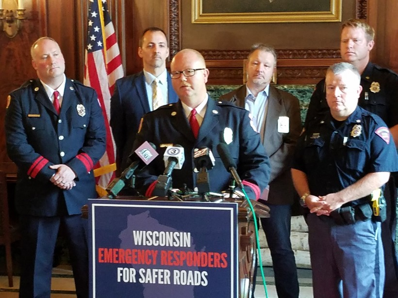 Police officers and firefighters call for a road funding fix.