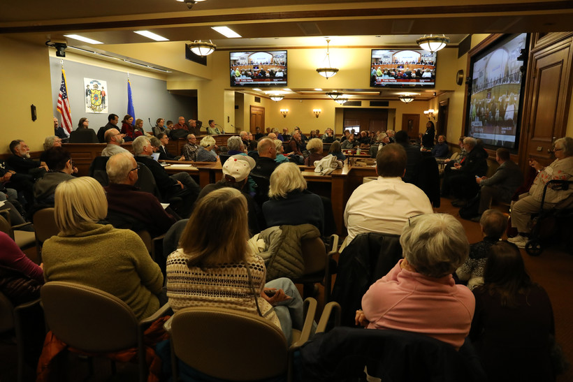 Members of the public occupy an overflow room during the Joint Finance Committee public hearing